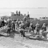 """Personnel of the Royal Canadian Army Medical Corps treating """"casualties"""" during the final rehearsal for Operation JUBILEE, the raid on Dieppe. England, August 1942."""