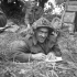 An unidentified infantryman of the 9th Canadian Infantry Brigade writing a letter home from the Normandy beachhead, France, ca. 8-9 June 1944.