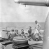 "Gun crew sunbathing on ""Y"" gun of the infantry landing ship H.M.C.S. PRINCE DAVID, Italy, July 1944."