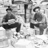 Private W. Sutherland (left) of The Westminster Regiment (Motor) and Private V.A. Keddy of The Cape Breton Highlanders repacking compo rations at a supply depot, Cassino, Italy, 18 April 1944.