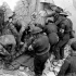 Personnel of The Loyal Edmonton Regiment digging out Lance-Corporal Roy Boyd, a comrade who was buried alive for 3 1/2 days in the wreckage of a demolished building, Ortona, Italy, 30 December 1943.